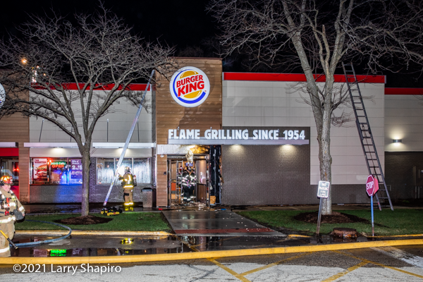 outside fire damages Burger King