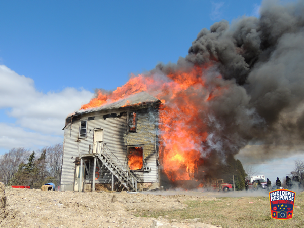 Firefighters burn a vacant house after using it for training