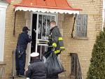 fire investigator and dogs at fire scene