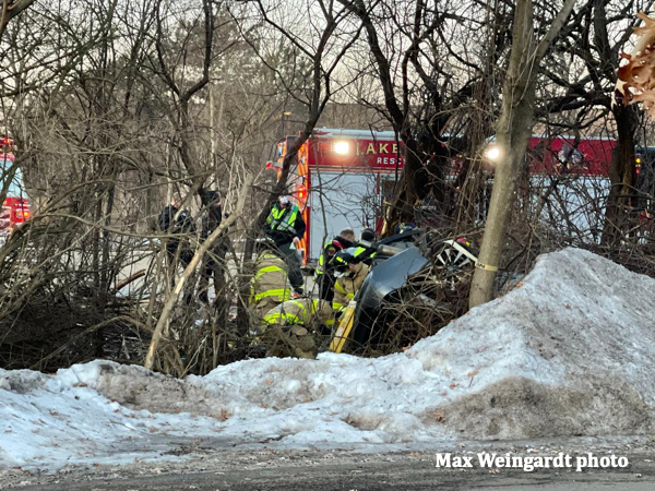 Firefighters in Lake Bluff IL rescue a crash vbictim