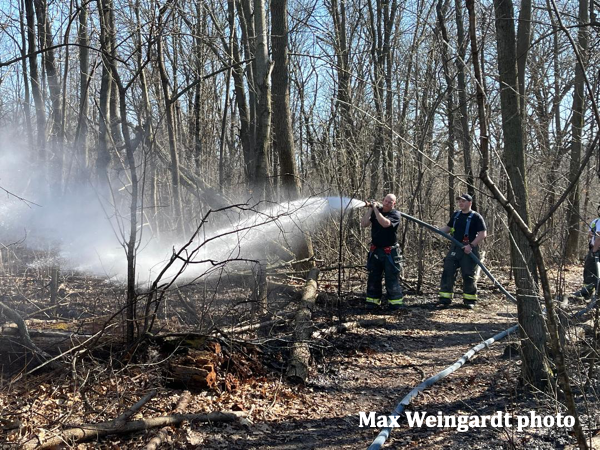urban Firefighters extinguish brush fire