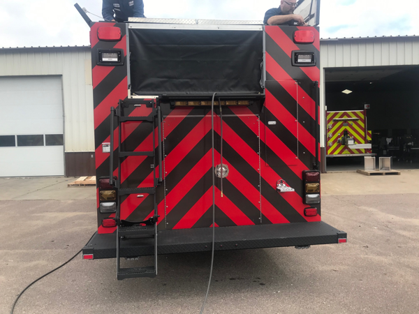 black and red chevron striping on fire engine