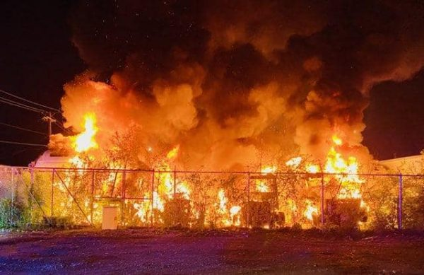 massive flames from many trucks on fire