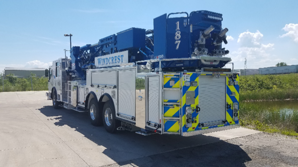 white fire truck with blue aerial ladder