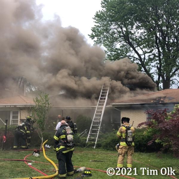 heavy smoke from suburban house fire