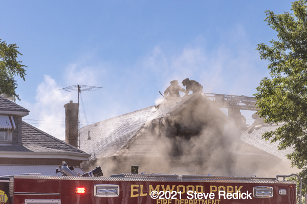 Firefighters vent roof in heavy smoke