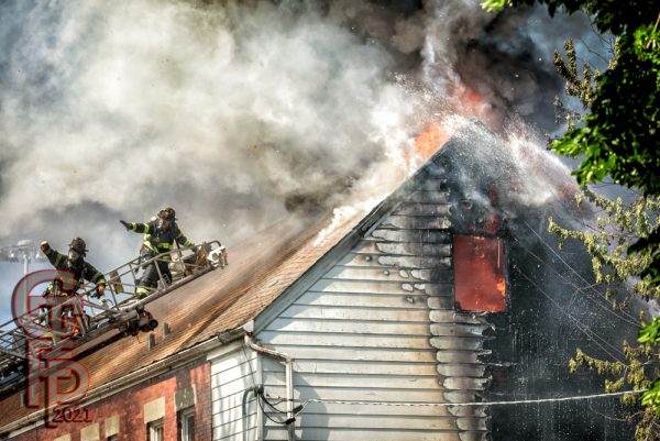 massive smoke and flames from roof of a building fire
