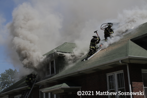 Firefighters on roof engulfed in smoke