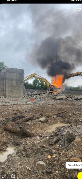 An excavator burned in Highland Park, IL 6/25/21