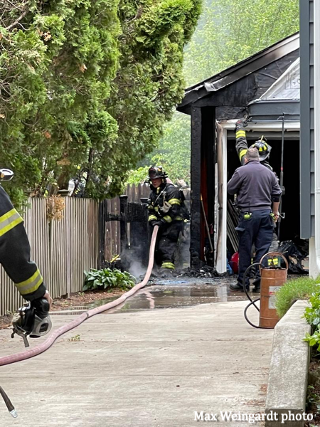 Firefighters stretching a hose line