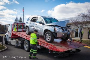 Gene's Towing with damaged Chevy Equinox
